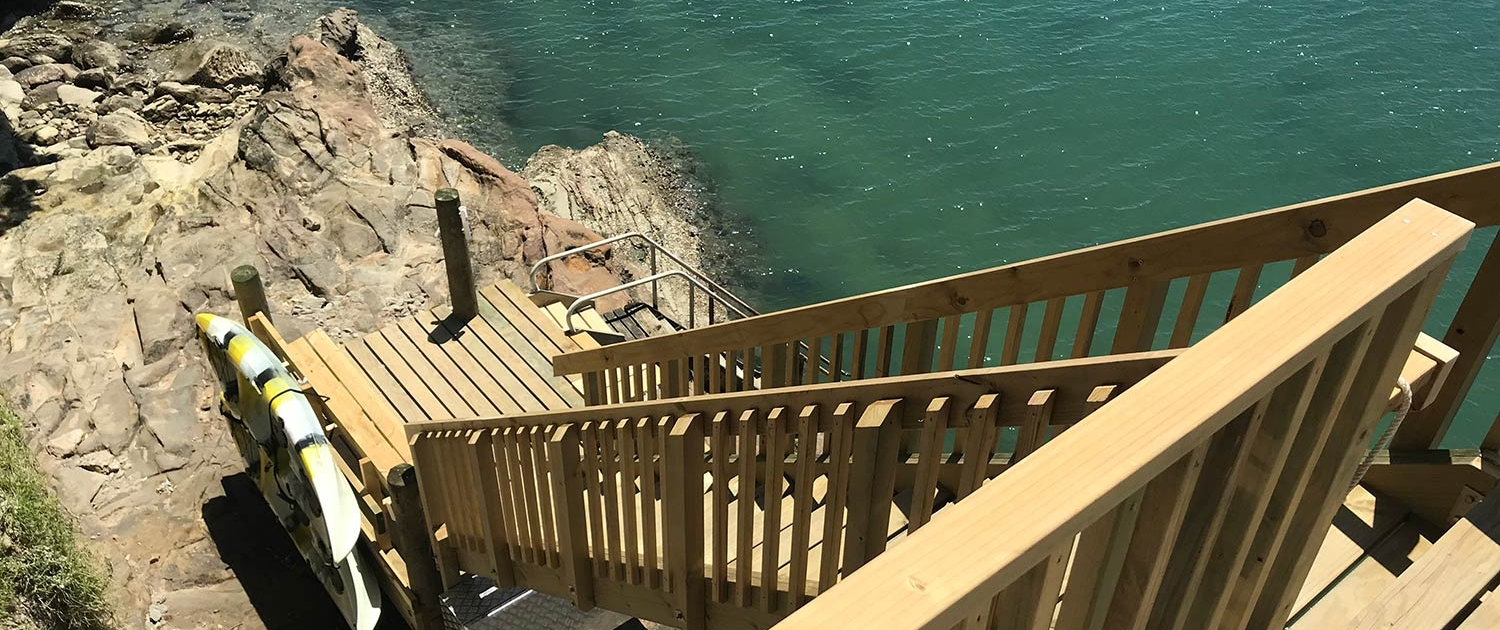 Image of beach staircase overlooking water